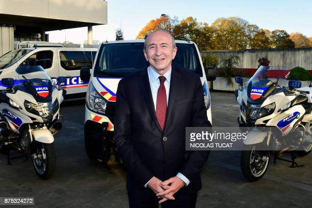 French Interior Minister Gerard Collomb poses for a photograph as he visits the Hotel de Police in Bordeaux southwestern France on November 17 to...
