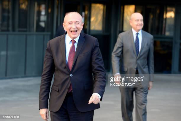 French Interior Minister Gerard Collomb smiles next to Bordeaux' mayor Alain Juppe as they visit the Hotel de Police in Bordeaux southwestern France...