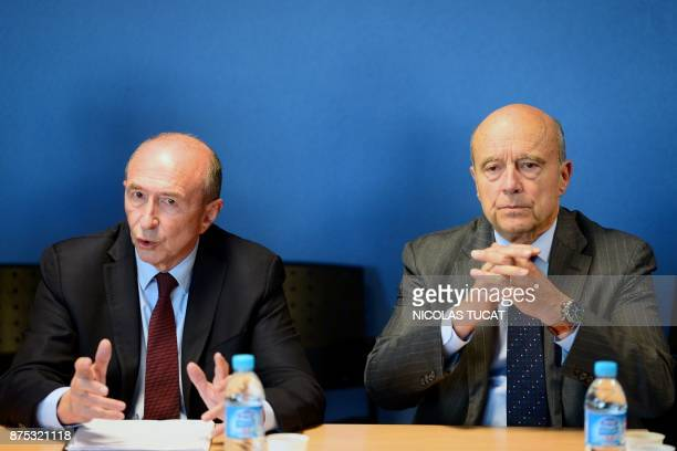 French Interior Minister Gerard Collomb speaks as Bordeaux' mayor Alain Juppe listens during a visit of the Hotel de Police in Bordeaux southwestern...