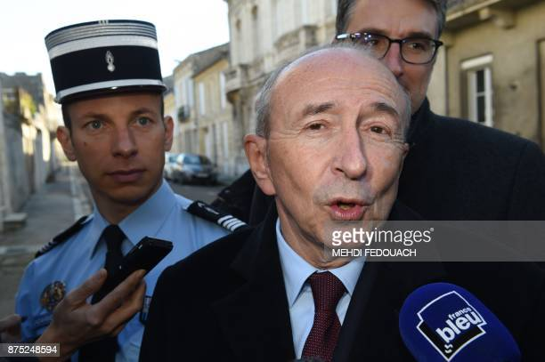 French Interior Minister Gerard Collomb speaks to the press after visiting the gendarmerie of Libourne on November 17 to launch consultations on the...