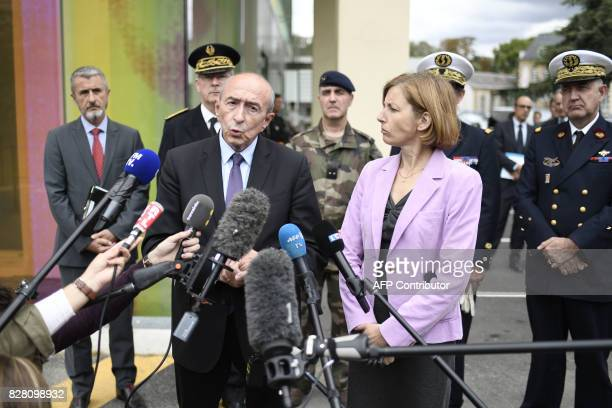 French Interior Minister Gerard Collomb speaks to the press next to French Defence Minister Florence Parly after meeting with soldiers wounded in an...