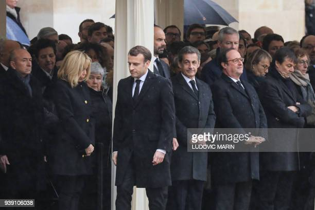 French Interior Minister Gerard Collomb the wife of the French President Brigitte Macron French Minister attached to the Interior Minister Jacqueline...