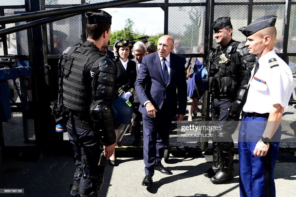 French Interior Minister Gerard Collomb (C) visits the French ...