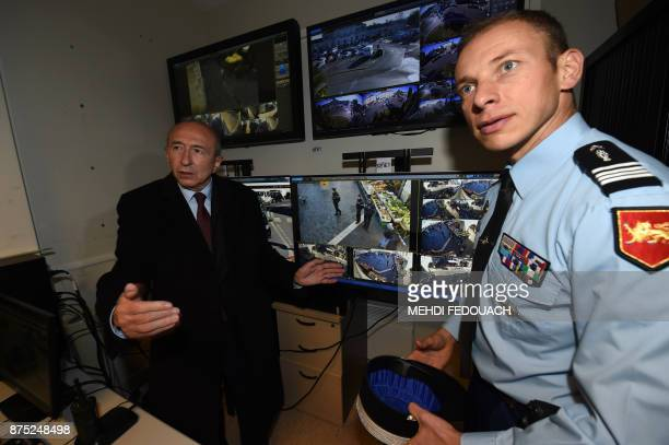 French Interior Minister Gerard Collomb visits the video surveillance post of the gendarmerie of Libourne on November 17 during a visit to launch...