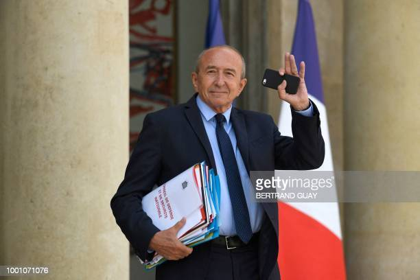 French Interior Minister Gerard Collomb waves as he leaves after a weekly cabinet meeting on July 18 2018 at the Elysee palace in Paris