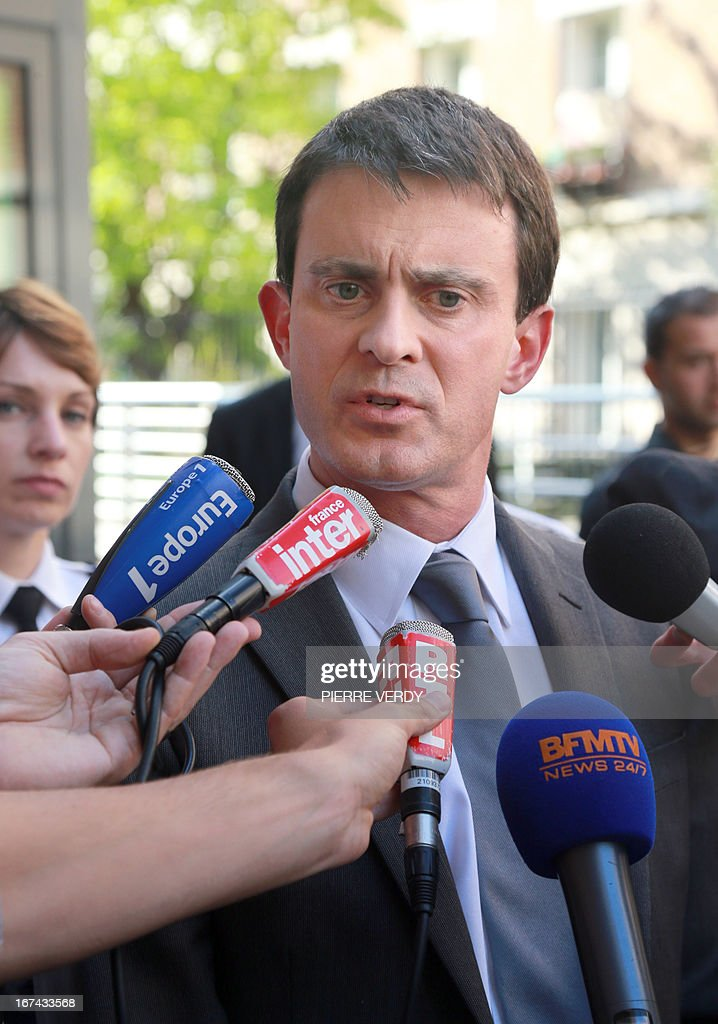 French Interior Minister Manuel Valls answers journalists' questions on an ambush and killing earlier in Corsica, after visiting a police station on April 25, 2013 in Paris. The president of Corsica's national park, Jean-Luc Chiappini, was shot dead in what was the third murder of a prominent public figure on the French Mediterranean island in the space of six months.