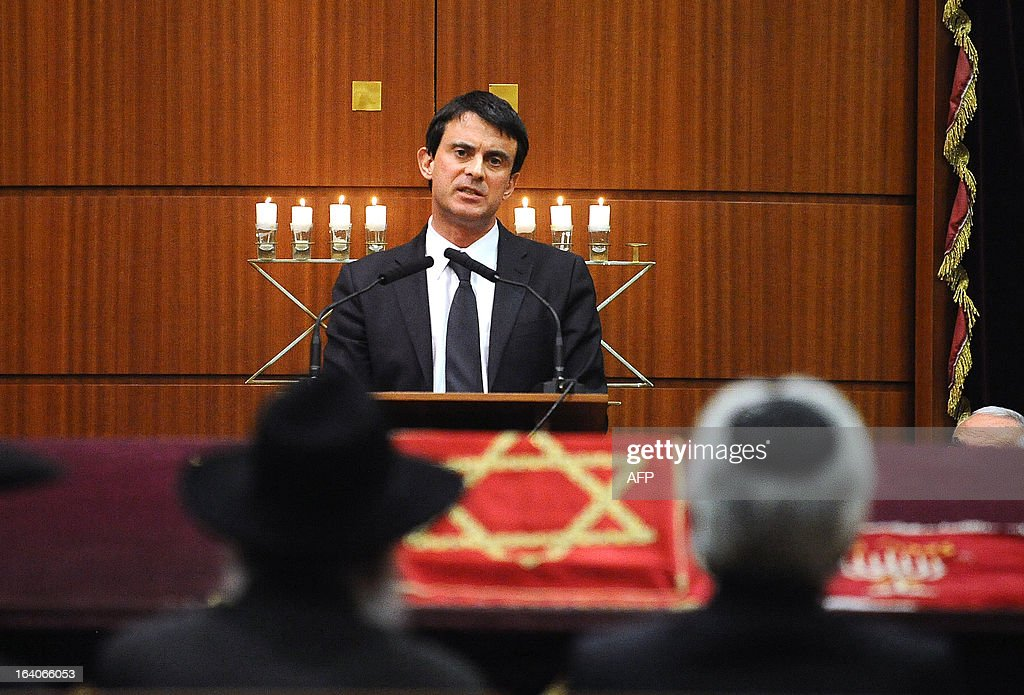 French Interior Minister Manuel Valls delivers a speech during an homage, on March 19, 2013, in the 'Espace du judaisme' in Toulouse, southwestern France, to those slain by Al-Qaeda-inspired gunman Mohamed Merah whose shooting spree in and around Toulouse left seven people dead in March 2012. GABALDA