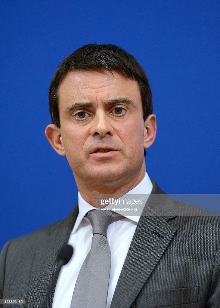 French Interior Minister Manuel Valls holds a press conference on January 1, 2013 at his ministry in Paris, a few hours after the New Year celebrations. Valls announced that 1,193 vehicles were burnt, including 344 by propagation, during the New Year's night.