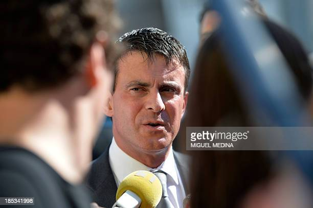 French Interior minister Manuel Valls speaks to journalists in Pointe-a-Pitre on the French Caribbean island of Guadeloupe on October 18, 2013....
