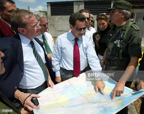 French interior minister Nicolas Sarkozy and head of French police Michel Gaudin listen to director of Colombian police general Teodoro Campo as they...