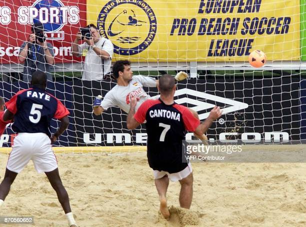 French international Eric Cantona scores from the penalty spot in the match between France and Spain in the the British leg of the Kronenburg beach...