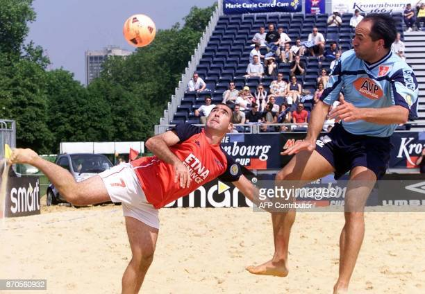 French international Eric Cantona shows his skills next to Swiss player Carmelo Rivolta in the match between France and Switzerland in the the...