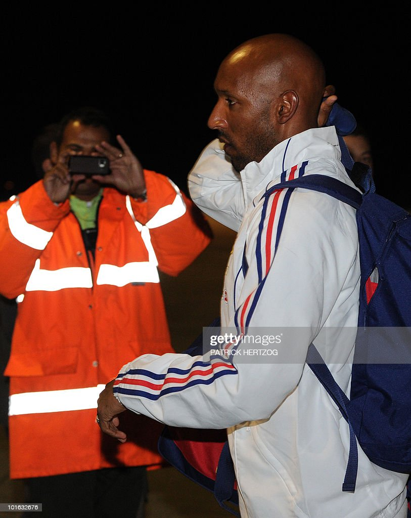French international football player Nicolas Anelka greets fans upon the arrival of the French team at George Airport on June 5, 2010. The FIFA 2010 World Cup begins on June 11, 2010.
