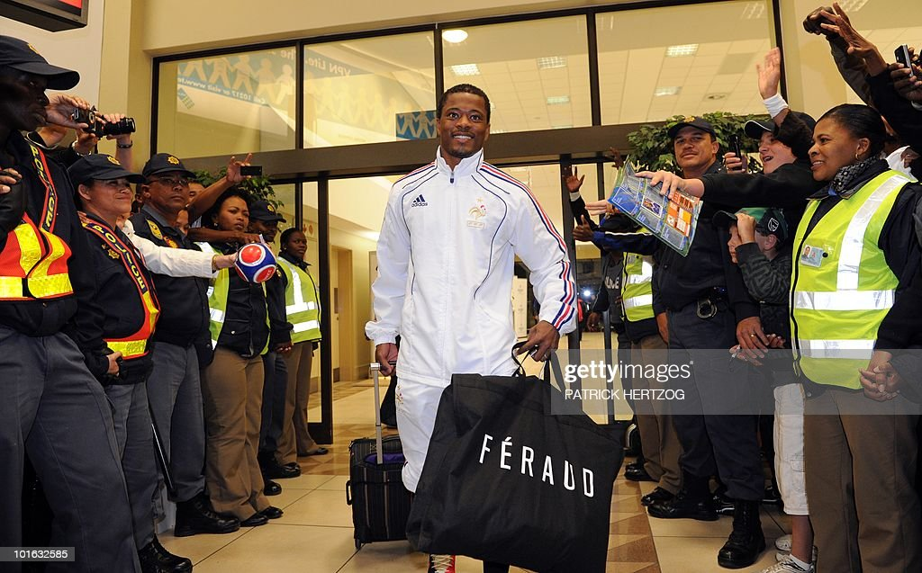 French international football team captain defender Patrice Evra smiles as fans cheer his arrival with team mates at George Airport on June 5, 2010. The FIFA 2010 World Cup begins on June 11, 2010.