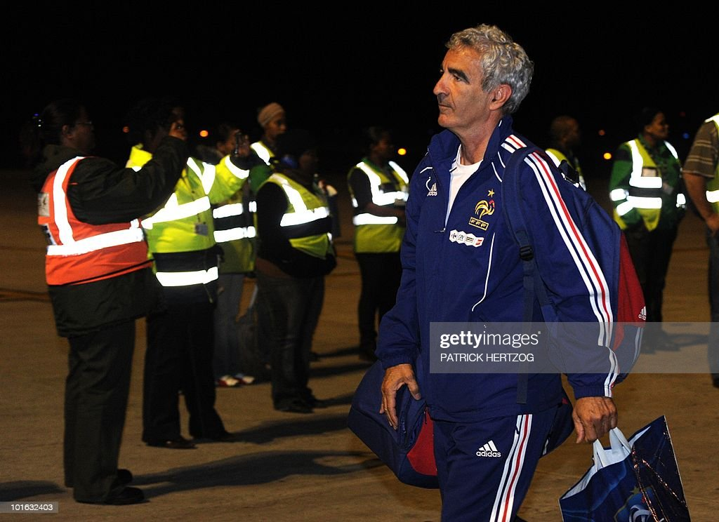 French international football team coach walks on the tarmac as the French team arrive at George Airport on June 5, 2010. The FIFA 2010 World Cup begins on June 11, 2010.