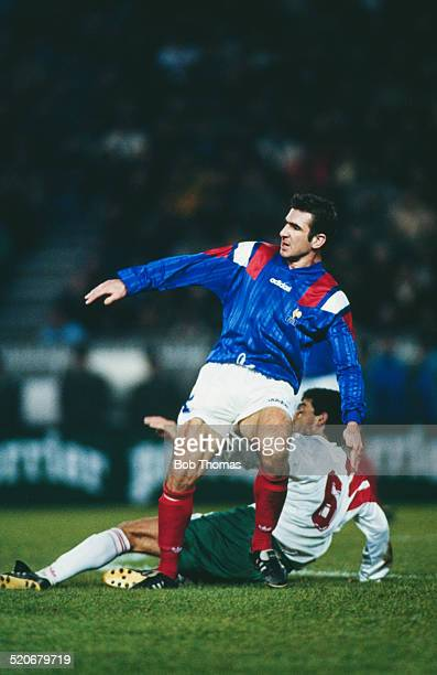 French international footballer Eric Cantona is tackled by Bulgaria's Yankov during the France v Bulgaria FIFA World Cup Qualifying Match Parc des...