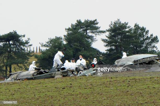 French investigators work on November 10 2012 on the scene of the accident where an Algerian military cargo plane travelling with six people on board...