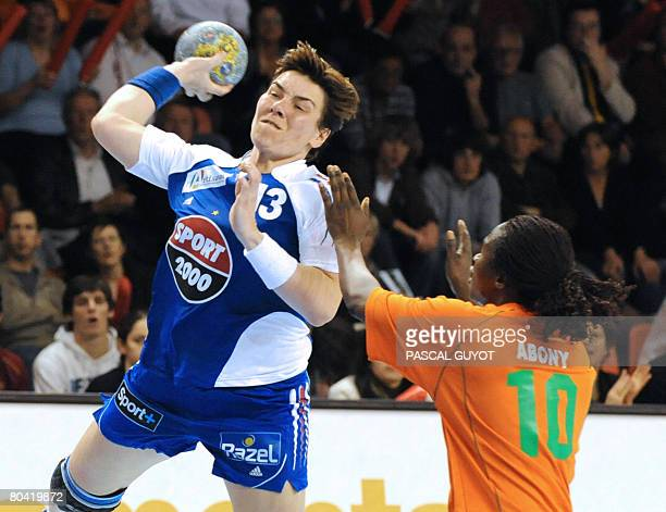 French Isabelle Wendling fights for the ball with Ivory Coast Abony N'Guessan Robeace on March 28 2008 in Nimes southern France during their women's...