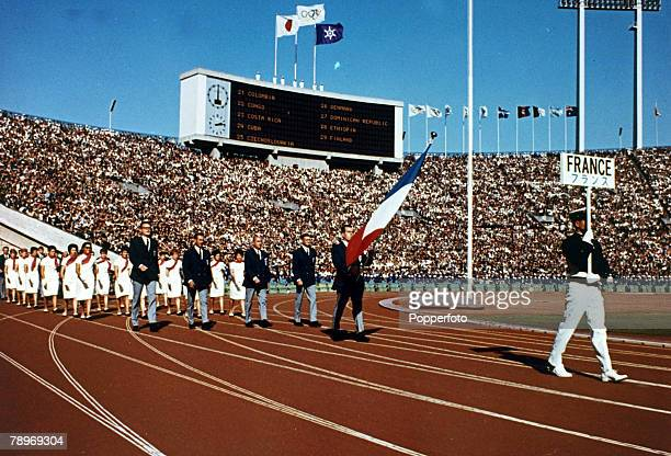 French javelin thrower Michel Macquet holds the national flag as he leads the France Olympic team on to the track during the opening ceremony of the...