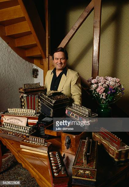 French jazz musician Marcel Azzola stands with his collection of accordions.