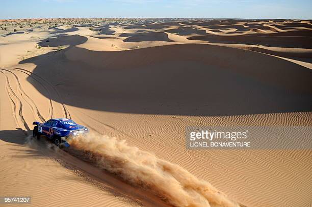 French Jean Louis Schlesser drives his buggy during the 10th stage Tenadi SaintLouis du Senegal of the Africa Eco Race on January 9 2010 The Africa...