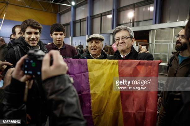 French Jean Luc Melenchon leader of Les Insoumis movement poses for pictures with an old Spanih 2nd Republic flag after a meeting with En Comu Podem...
