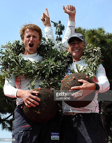 French Jean Pierre Dick and Loick Peyron celebrate after winning the second edition of the Barcelona World Race a nonstop westtoeast roundtheworld...