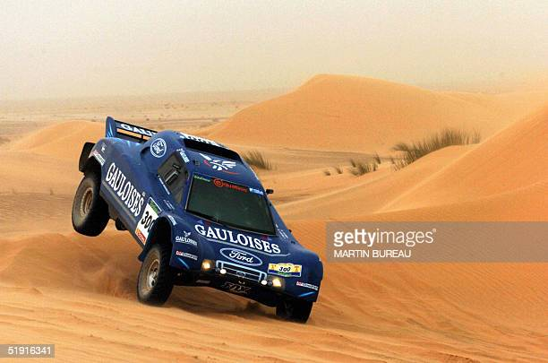 French JeanLouis Schlesser drives his buggy 05 January 2005 during the sixth stage of the 27th Dakar Rally between Smara and Zouerat in Mauritania...