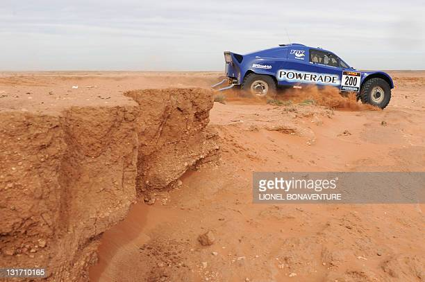 French JeanLouis Schlesser drives his Schlesser buggy during the first stage between Nador and Boutnib of the first edition of the Africa Race on...