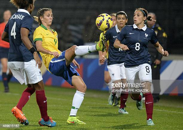 French Jessica Houara vies for the ball against Brazil's Darlene De Souza Reguera during an international women friendly football match France vs...