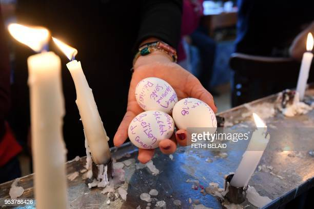 A French Jew holds eggs bearing writing expressing her wishes that will be placed in a cave under the Ghriba synagogue in Tunisia's Mediterranean...
