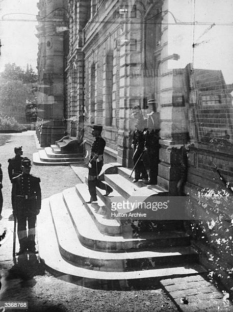 French Jewish army officer Alfred Dreyfus leaves the courtroom at Rennes after the retrial of his case The double file of army officers turn their...