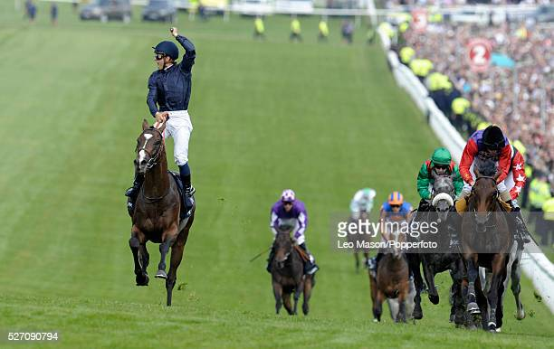 French jockey Mickael Barzalona riding Pour Moi comes up the finishing hill to win the Investec Derby race ahead of Treasure Beach and the favourite...