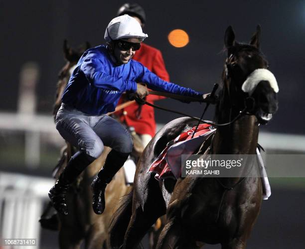 French jockey Mikael Barzalona jumps off Monterosso after winning the Dubai World Cup horse race at the Meydan race track in the Gulf emirate on...
