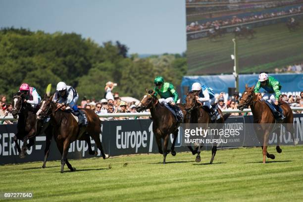 French jockey Stephane Pasquier rides his horse Senga as they lead the race of the Prix de Diane a 2100meters flat horse race on June 18 2017 at the...