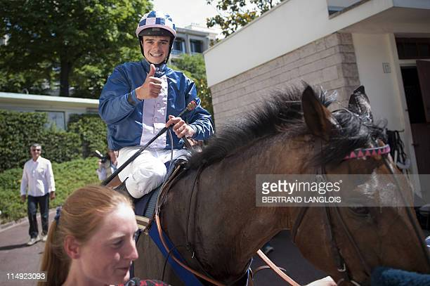 French jockey Sylvain Dehez celebrates on his horse Mid Dancer after winning the Gras Savoye Grand SteepleChase of Paris horse racing on May 29 2011...