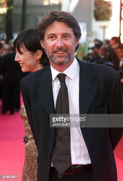 French journalist actor and director Antoine De Caunes poses with his girlfriend French actress Elsa Zylberstein upon his arrival at the Palais des...