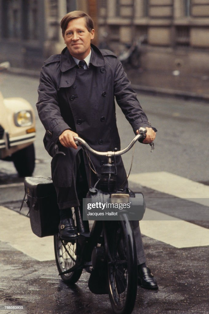 French journalist Alain Duhamel riding a solex.