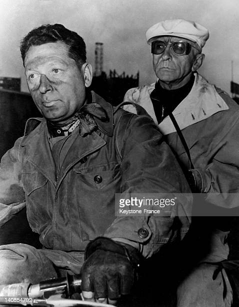 French Journalist Alex Viro and his motor cyclist Rene Wagner during the Tour De France during 1957 in France