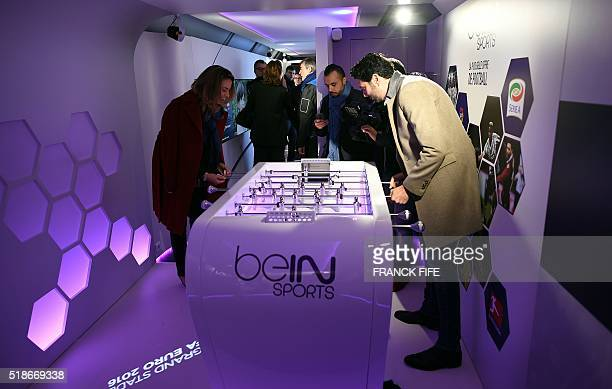 French journalist Alexandre Ruiz plays with BeIn Sports journalist AnneLaure Bonnet in the 'UEFA EURO 2016 Trophy tour' train stationed in Gare de...