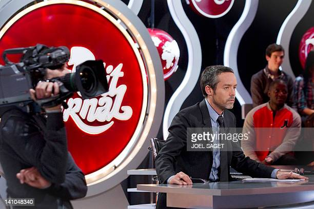 French journalist and anchorman Yann Barthes is pictured during a TV broadcast show 'Le Petit Journal' on Canal Plus channel on March 9 2012 in Paris...