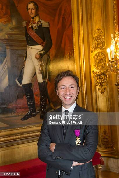 French journalist and author Stephane Bern poses by a painting of King Leopold I of Belgium after he was appointed officer in the King Leopold order...