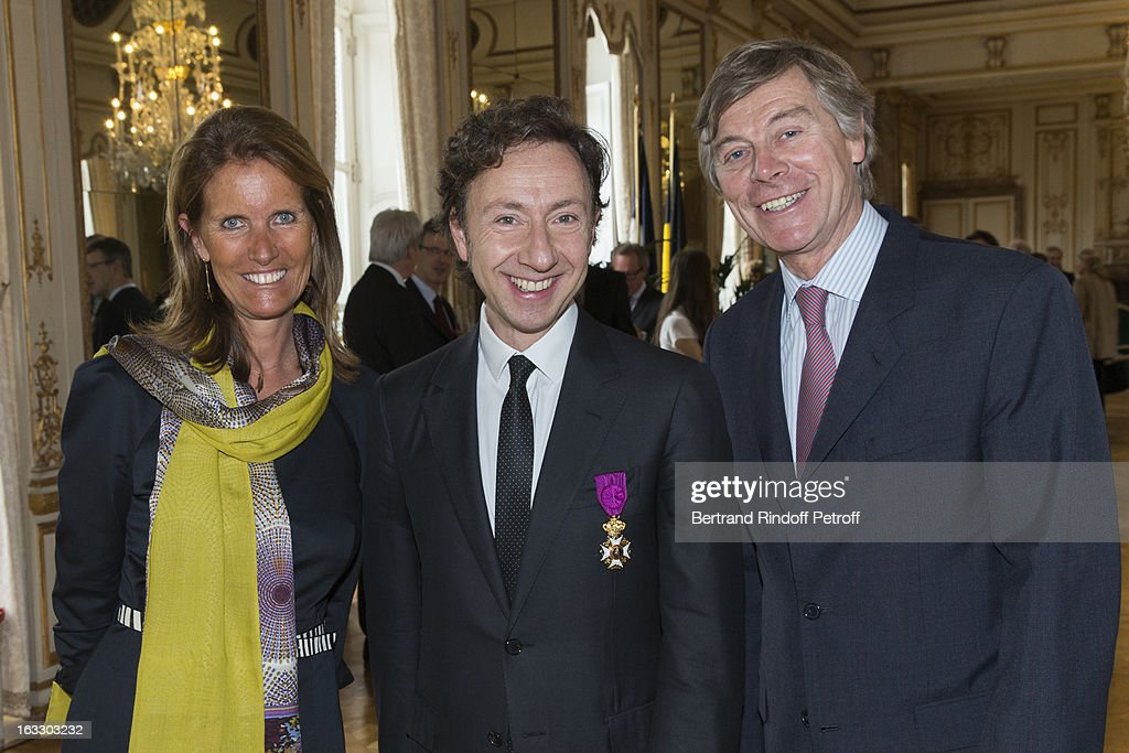 French journalist and author Stephane Bern (C) poses with Belgian Ambassador to France Patrick Vercauteren Drubbel (R) and his wife Alessandra Vercauteren Drubbel after Bern was appointed officer in the King Leopold order during a ceremony at Palais d'Egmont on March 7, 2013 in Brussels, Belgium.