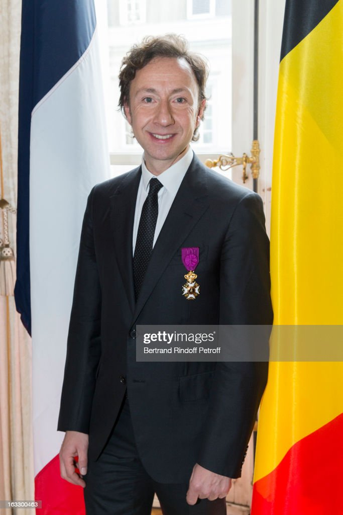 French journalist and author Stephane Bern poses with his insignia after he was appointed officer in the King Leopold order during a ceremony at Palais d'Egmont on March 7, 2013 in Brussel, Belgium.