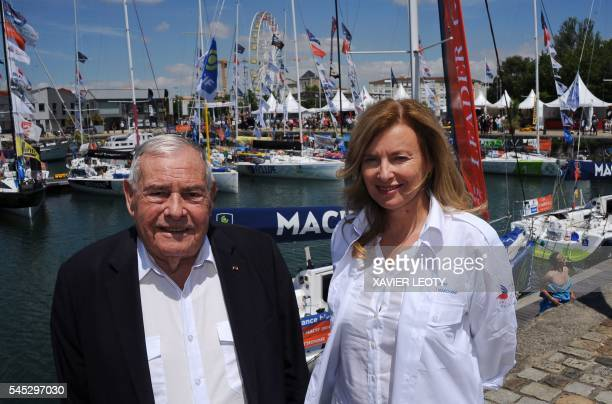 French journalist and former first lady of France Valerie Trierweiler and President of charity association Secours Populaire Julien Laupretre pose...