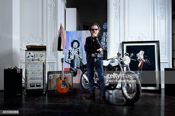 French Journalist and music critic Philippe Manoeuvre poses with the objects of the Rock'n'Roll auction sale Artcurial on October 28 2013 in Paris...