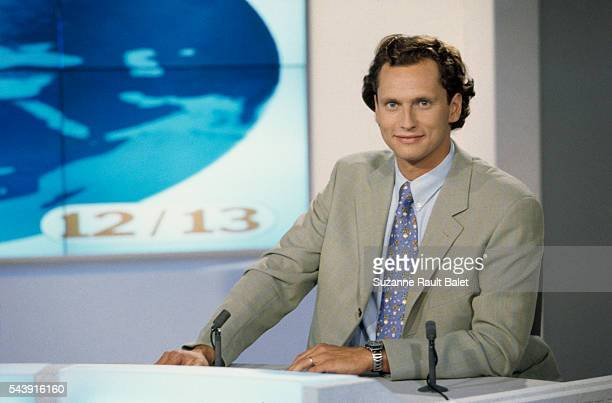 French journalist and newscaster Louis Laforge on the set of the afternoon news 12/13 on French channel France 3