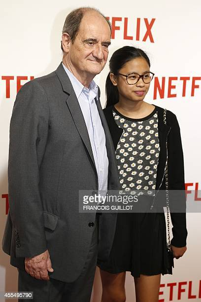 French journalist and television executive Pierre Lescure and his daughter Anna pose during a photocall for the launch of Netflix in France on...
