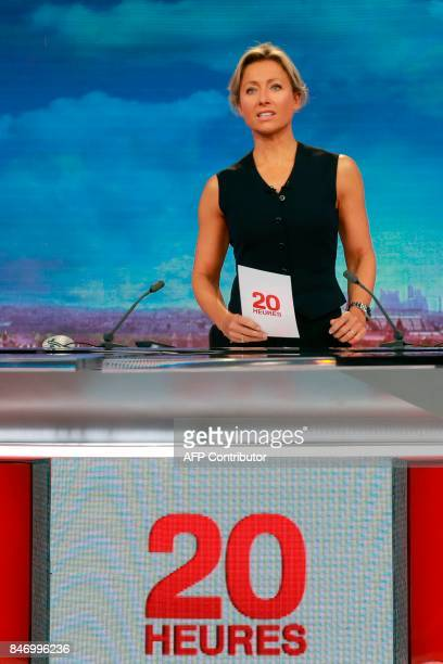 French journalist and TV host AnneSophie Lapix arrives on the set before presenting the broadcast news of the French TV channel France 2 in Paris on...