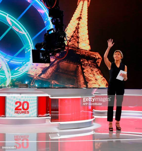 French journalist and TV host AnneSophie Lapix stands on the set before presenting the broadcast news of the French TV channel France 2 in Paris on...